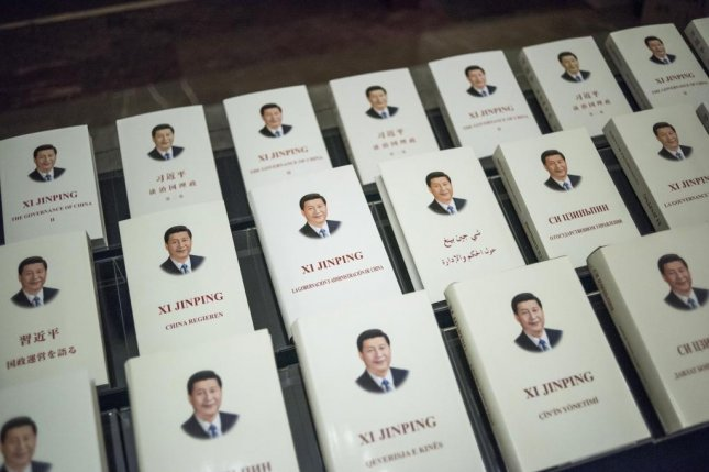 Books written by China's President Xi Jinping, translated into foreign languages, are on display during the opening ceremony of the World Political Parties Dialogue at the Great Hall of the People in Beijing on Friday. Pool Photo by Fred Dufour/EPA