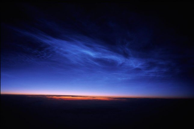 Noctilucent clouds are only seen during dawn and dusk, when the rising and setting sun illuminate the ice crystals from below. Photo by NASA