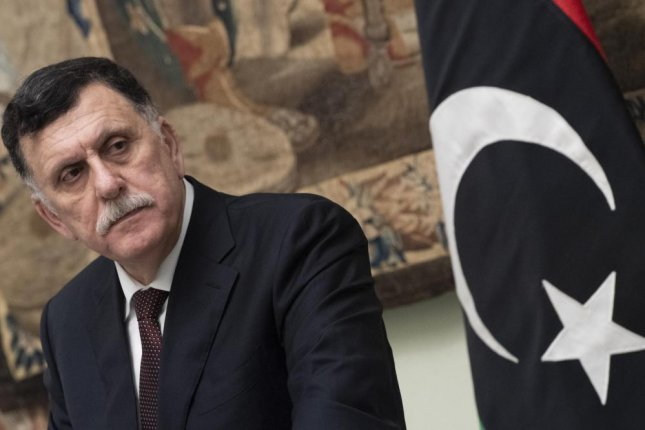Libya's Government of National Accord Prime Minister Fayez al-Sarraj shown during a press conference with Italian Prime Minister Conte on Jan. 11. The GNA said Thursday it has fully recaptured Tripoli from rebel forces. Photo by Claudio Peri/EPA-EFE