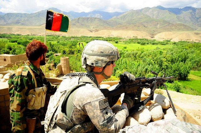 The U.S. Army provides security alongside an Afghan National Army Soldier at an ANA compound in Parwa'i village in eastern Afghanistan's Nuristan province. File Photo U.S. Army.