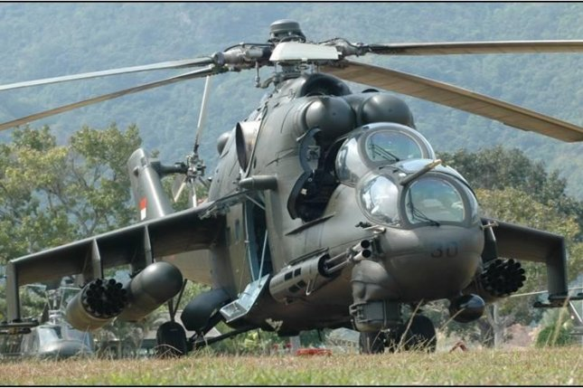 Russian Helicopters has signed supply contracts to provide support services for the Thai and Indonesian air forces, the company announced this week. The deal calls for the company to supply parts for Indonesia's Mi-35P helicopter, shown here. Photo by Dinas Penerangan/Wikimedia Commons