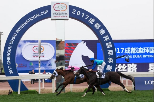 Sky Gazer, with Royston Ffrench aboard, wins the fourth annual Chengdu Dubai International Cup in mainland China. Photo courtesy of Neville Hopwood/Dubai Racing Club