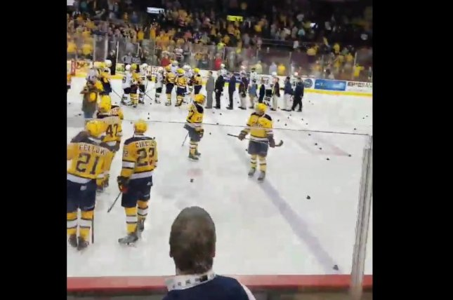 Cowbells litter the ice at Erie Insurance Arena after the Erie Otters' victory over the London Knights. Screenshot: scottymofo/Twitter