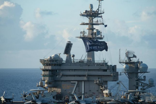 The aircraft carrier USS Theodore Roosevelt flies a replica of Capt. Oliver Hazard Perry's Don't Give Up the Ship flag Wednesday. Photo by Will Bennett/U.S. Navy