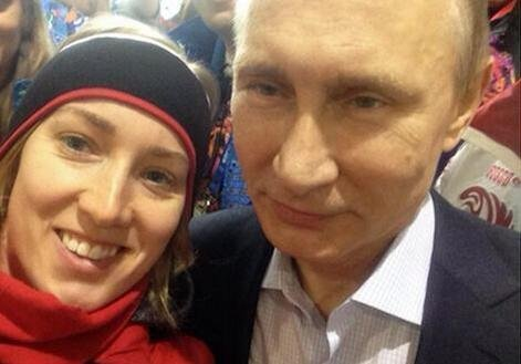 Canadian speed skater Brittany Schussler took this photo of herself with Russian President Vladimir Putin on Feb. 14. (Twitter/@bschussler)
