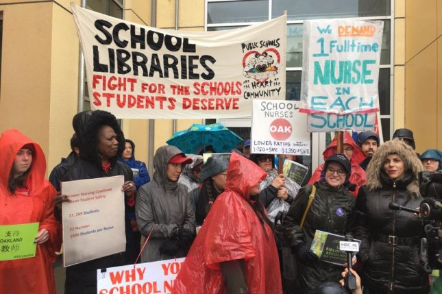 Nurses and librarians strike in Oakland Wednesday as teachers in Kentucky called for a mass sickout to protest a pension bill. Photo courtesy Oakland Education Association/Twitter