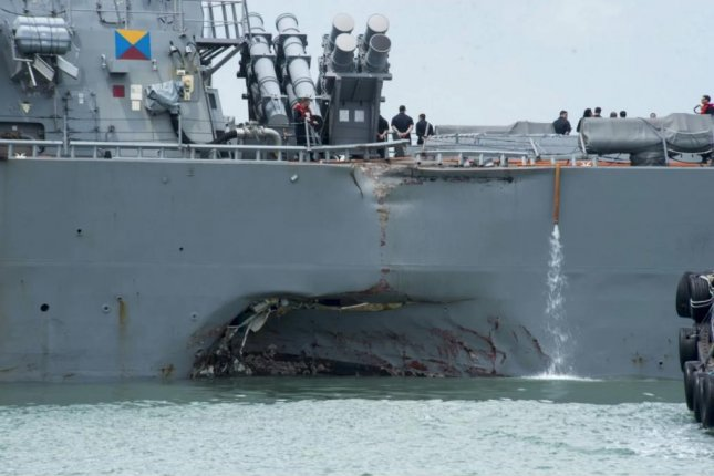 The USS John S. McCain's damaged hull is visible while berthed at the Changi Navy Base in Singapore on Aug. 21. Photo courtesy of U.S. Navy
