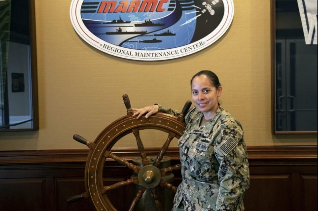 Chief Machinist's Mate Mayra Hudgens, a Bronx, N.Y., native assigned to Mid-Atlantic Regional Maintenance Center, recently became the first female Sailor to earn the U.S. Navy's Steam Generating Plant Inspector certification. Photo by Hendrick L. Dickson/U.S. Navy
