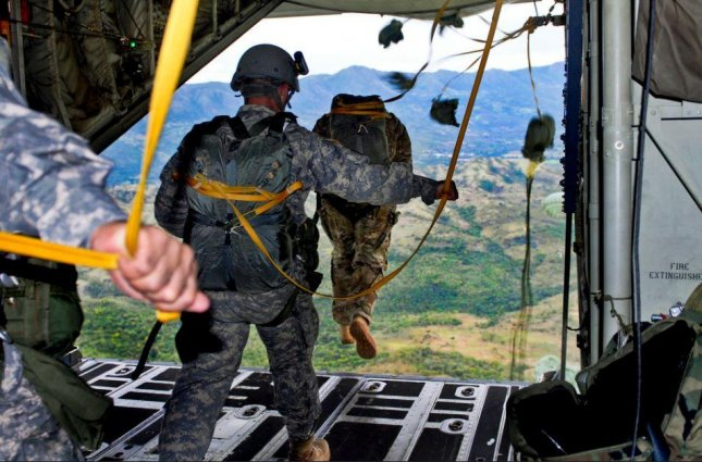 Secretary of Defense Lloyd Austin realigned U.S. Special Operations Command and its responsibility for reporting to his office, partially reversing a Trump-era decision to raise the command to that of the other U.S. military branches. Pictured, U.S. Army Special Operations troops practice jumping from a C-130 cargo plane. Photo courtesy of U.S. Army
