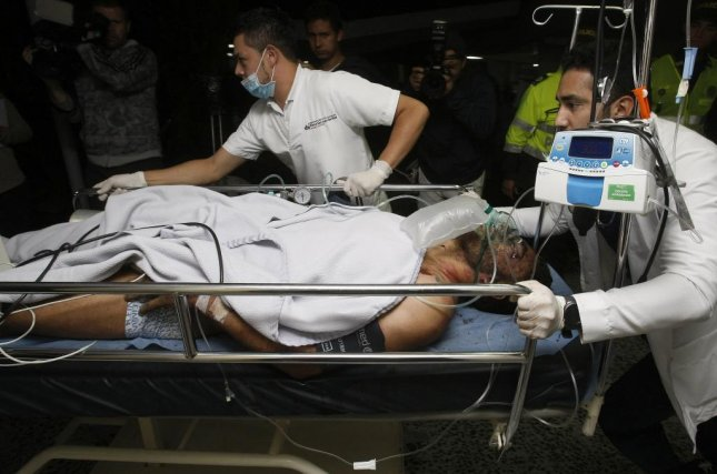 Medical staff from the San Juan de Dios hospital transport Brazilian soccer player Alan Ruschel as he arrives in La Ceja in Colombia on Tuesday, after surviving a plane crash. The Chapecoense team were scheduled to play in the Copa Sudamericana final against the Medellin's Atletico Nacional on Wednesday. Photo by Luis Eduardo Noriega A/European Photo Agency