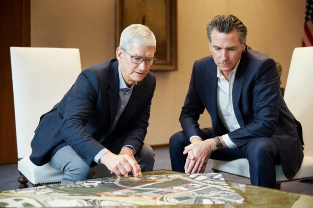 Apple CEO Tim Cook and California Gov. Gavin Newsom look over a map of San Jose in the heart of Silicon Valley where Apple plans to contribute $2.5 billion to help with the housing crisis. Photo from Apple/apple.com/newsroom