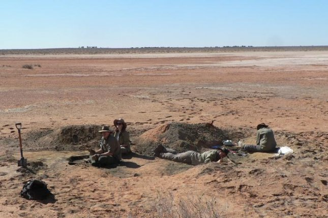 A team of paleontologists from Flinders University excavates the remains of an ancient raptor near Lake Pinpa in southern Australia. Photo by Trevor Worthy/Flinders University