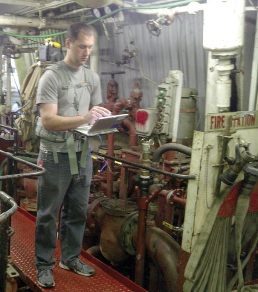 An APL engineer uses EMAPS aboard a ship to generate a map. Credit: John Hopkins University.