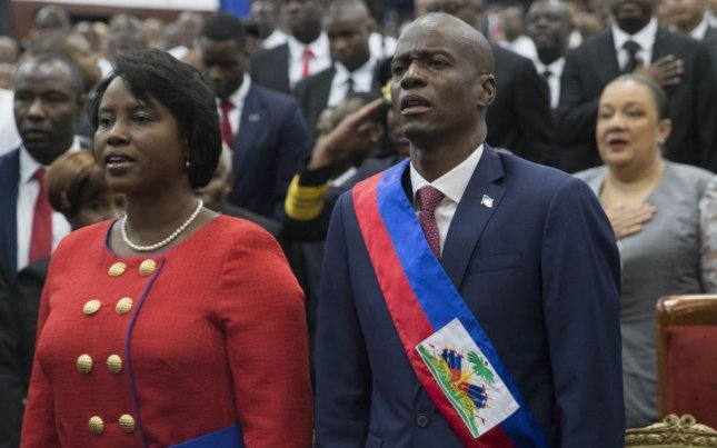 Standing with his wife in Haiti's parliament building in Port-au-Prince, Jovenel Moise was inaugurated Haiti's new president on Tuesday. Photo by Orlando Barria/EPA