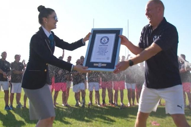 Former members of England'sHoylake Rugby Club, which disbanded in 2001, reunited to play a game of touch rugby for 33 hours, 33 minutes and 33 seconds to break a Guinness World Record and pay tribute to teammate Dan Miller, who died of a heart attack in June 2020. Photo courtesy of Guinness World Records