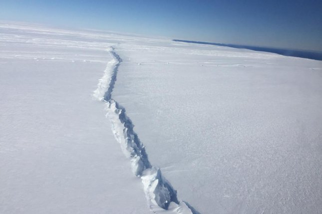 Scientists spotted a newly formed rift on the Pine Island Glacier ice shelf during an aerial survey on November 4, 2016. Photo by Nathan Kurtz/NASA