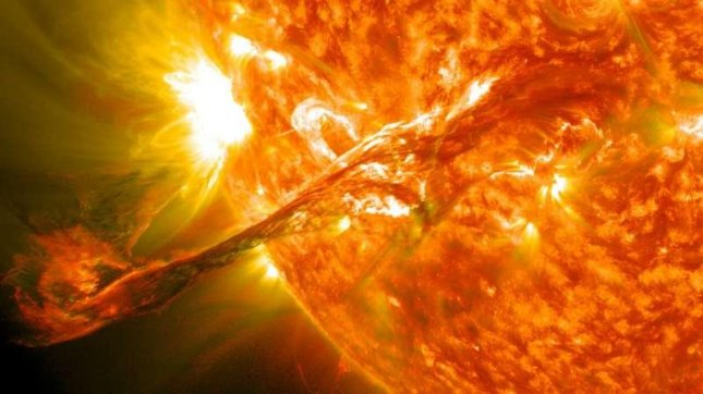 A coronal mass ejection, such as the one seen erupting into space in 2012, can send particles hurtling through space toward the Earth -- events that can harm satellites and electronics, as well as people. Photo courtesy of NASA/GSFC/SDO