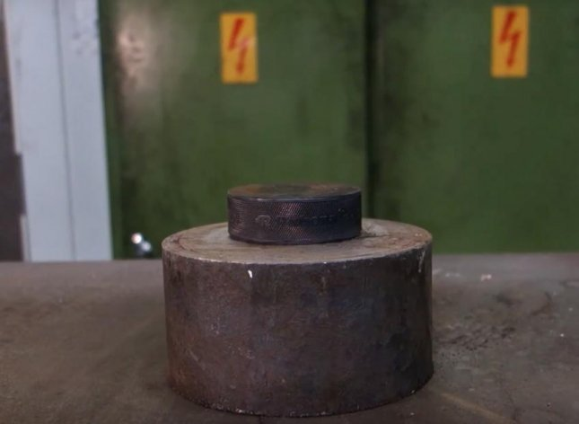 youtube user attempts to crush hockey puck with hydraulic press