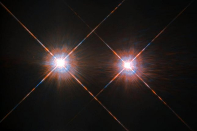 Centauri A and B make up two of the three stars in the Alpha Centauri system, Earth's closest stellar neighbor. Photo by NASA