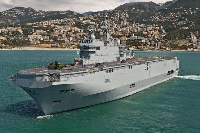France to deliver carriers built for Russia and canceled to Egypt this summer. Pictured, the French Mistral-class carrier Dixmude. Photo by Simon Ghesquiere/Marine Nationale/Wikimedia Commons