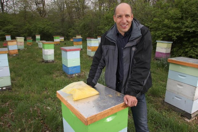 Entomologist Christian Krupke poses with bee houses at the Purdue Bee Laboratory. Photo by Tom Campbell/Purdue