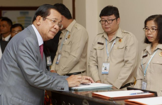 Cambodian Prime Minister Hun Sen (R) attends a meeting at the National Assembly in Phnom Penh, Cambodia on October 16. This week, the European Union took measures against the Cambodian government for alleged human rights abuses. File Photo by Kith Serey/EPA