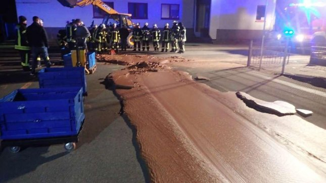A spill at a German factory caused a road outside the building to become encrusted in chocolate. Photo courtesy of the Werl Fire Brigade