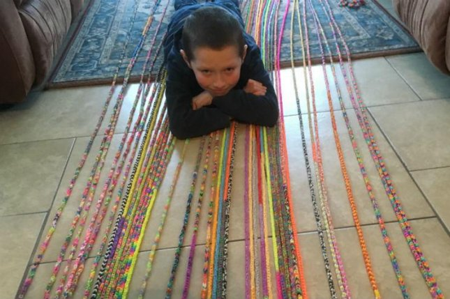 A 10-year-old Northern Ireland boy broke a Guinness World Record by weaving a loom band bracelet measuring nearly 6,292 feet. Photo courtesy of Guinness World Records