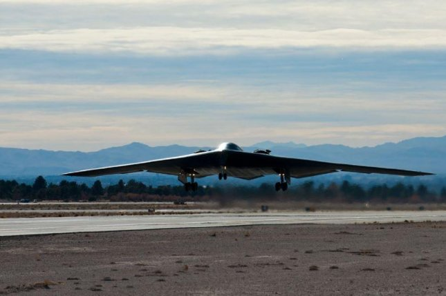 A B-2 Spirit bomber, pictured, will join a B-1B Lancer and B-52 Stratofortress in the flyover at the Super Bowl on Feb. 7.  Photo by A1C Thomas Spangler/USAF