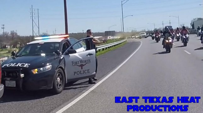 A Fort Worth police officer discharges his pepper spray toward a group of motorcyclists. Screenshot: East Texas Heat Productions/YouTube