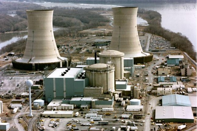 The Three Mile Island nuclear generating station suffered a partial meltdown at one of its reactors in 1979. The reactors are in the smaller domes with rounded tops and the large smokestacks are cooling towers. The plant's owner, Exelon, announced it will close the one remaining operating reactor in 2019. 1979 file photo by Wikimedia Commons/U.S. Department of Energy