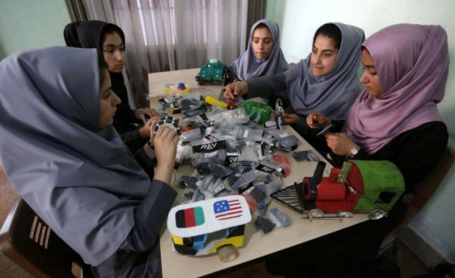 A team of teenage girls from Herat, Afghanistan, began their travel to Washington on Friday to participate in a robotics competition. They were twice denied visas by the States Department, but were approved for entry to the United States after an order by President Donald Trump. Photo by Jalil Rezayee/EPA