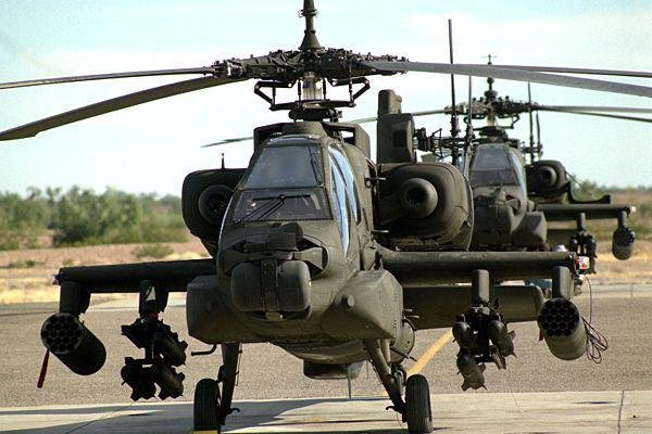 Kuwait is seeking support for its Apache helicopters through a U.S. Foreign Military Sales deal. Pictured, AH-64 Apache attack helicopters. U.S. Army photo