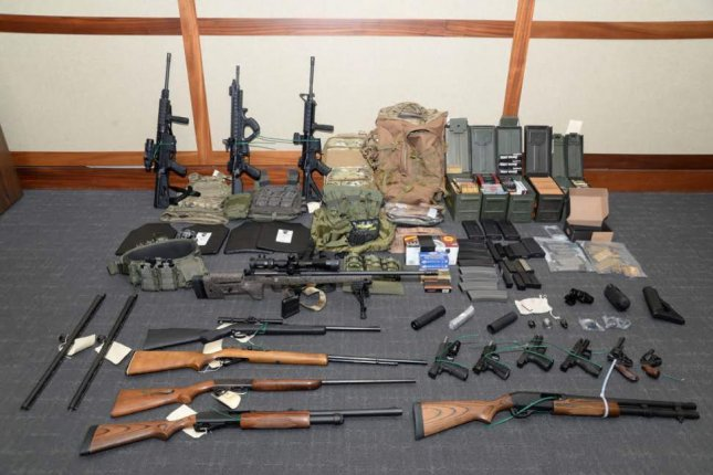 Hasson compiled a cache of weapons in his Silver Spring, Md., home -- including 15 firearms and 1,000 rounds of ammunition, prosecutors said. Photo courtesy U.S. Attorney's Office for the District of Maryland/UPI