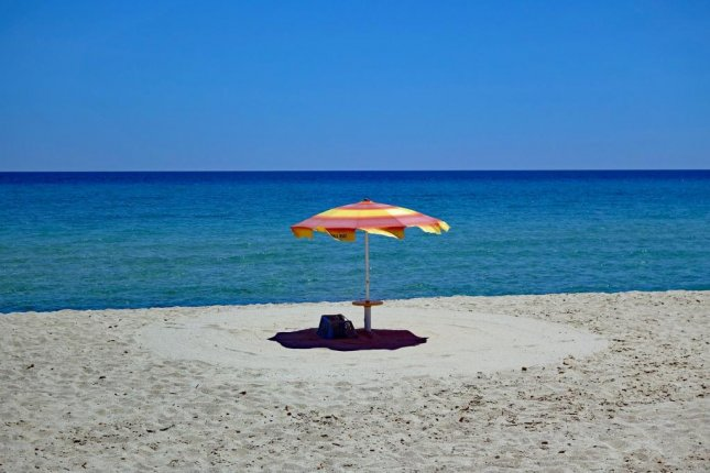 Authorities on the Italian island of Sardinia said a French tourist was fined $1,200 for attempting to leave the country with 4.4 pounds of white sand from a local beach. Photo byStephanieAlbert/Pixabay.com
