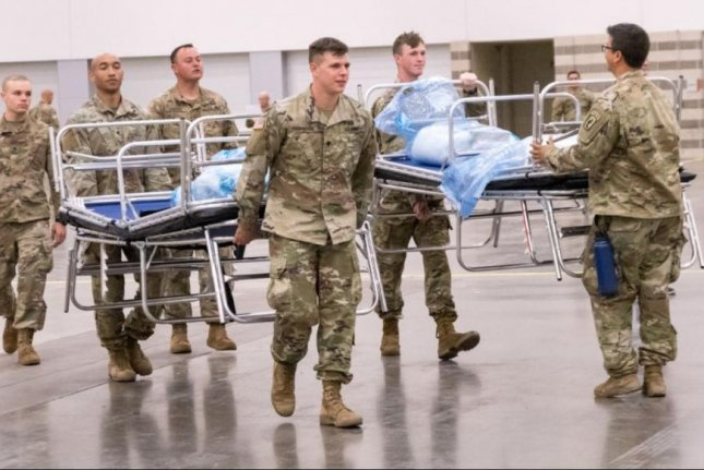 The U.S. Fifth Army announced the departure on Wednesday of 740 military medical and support personnel, dealing with the COVID-19 pandemic, from Texas and California hospitals to their home units. Photo courtesy of A1C Charissa Mencken/National Guard