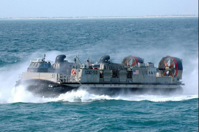 Landing Craft, Air Cushion 50 transits alongside the amphibious transport dock ship USS San Antonio during a friends and family day cruise in 2006. Photo by Charles A. Ordoqui/U.S. Navy