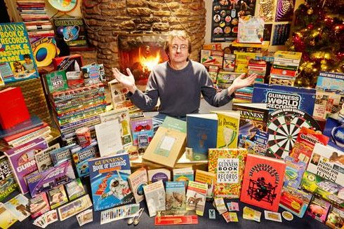 Martyn Tovey with his Guinness Book of World Records collection. Photo courtesy Guinness World Records