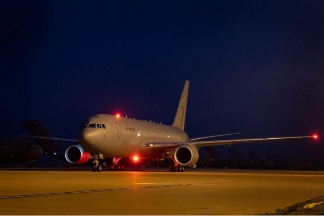 A KC-46 Pegasus refueling tanker taxis on the 97th Air Mobility Wing flightline on Monday night at Altus Air Force Base in Oklahoma. Photo by Technical Sgt. Kenneth Norman/U.S. Air Force