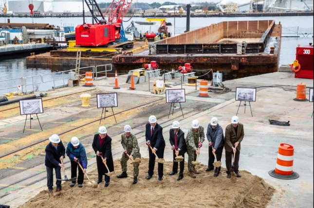 Officials from the Pentagon, Navy, city of Portsmouth and Norfolk Naval Shipyard, among others, participate in a groundbreaking for the yard's Dry Dock 4 renovation on Jan. 23. Photo by Shelby West/NNSY