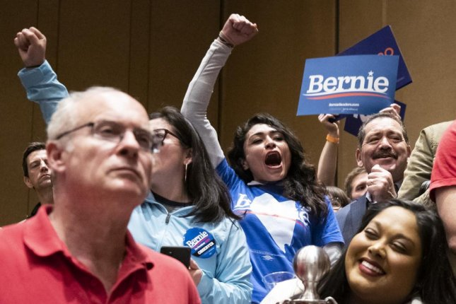 U.S. senator Bernie Sanders supporters react during the caucus in a ballroom of the Bellagio Hotel and Casino in Las Vegas, Nev., Saturday. By 5 p.m. multiple media outlets had called the caucuses in Sanders' favor. Photo by Etienne Laurent/EPA-EFE