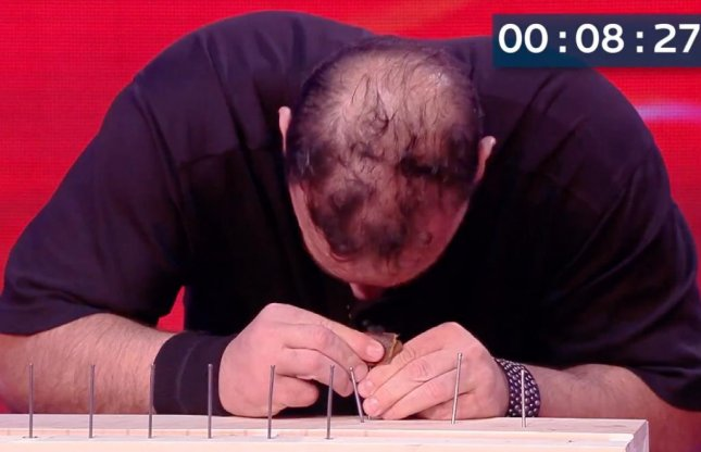 John Ferraro, an American professional wrestler and strongman, set a Guinness World record by hammering 38 nails with his head in two minutes. He attributes his success to preparation, training and dedication to the goal.  Screen capture/Guinness World Records/YouTube