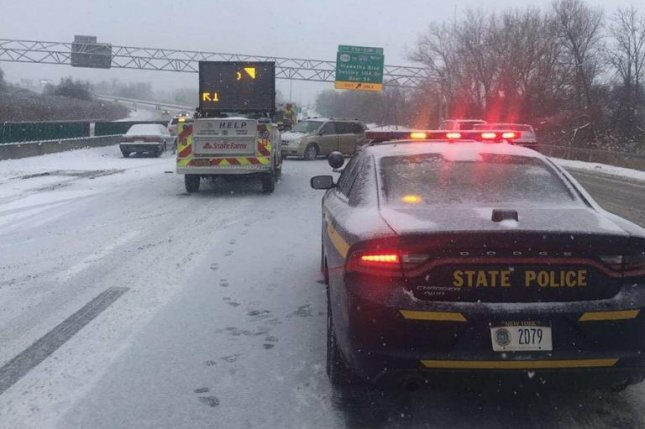 A winter storm that canceled thousands of flights in the Midwest made its way to the Northeast on Sunday, causing frigid conditions and further travel delays. Photo courtesy New York State Police/Twitter