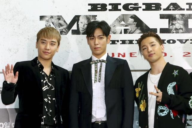 Seungri (L), a former member of South Korean boy band Big Bang, has apologized for sex assault allegations at a nightclub he owns in southern Seoul. File Photo by Yonhap/EPA-EFE