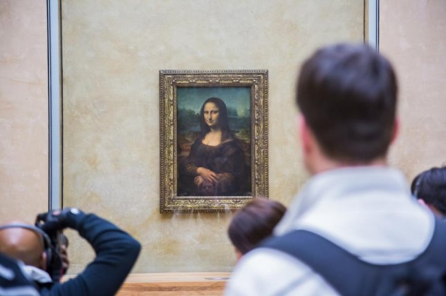 French scientist Pascal Cotte, who has examined the Mona Lisa for more than a decade, has said his analysis has proven that the woman seen in Leonardo da Vinci's masterpiece is not who art historians think she is. Cotte said other images painted beneath the portrait suggest that her identity remains unknown. Photo by S-F/Shutterstock