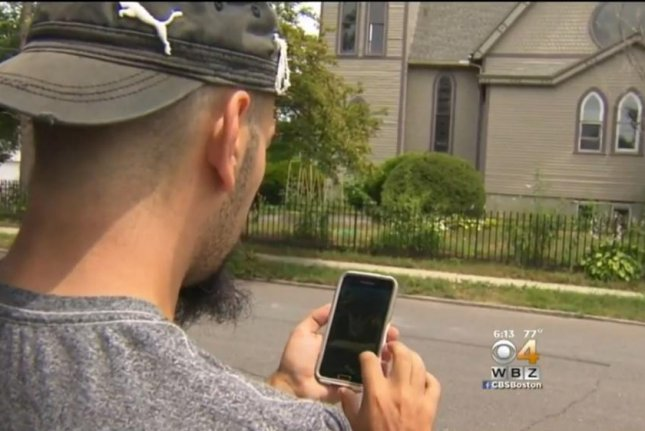 A Pokemon Go player accesses the gym at Boon Sheridan's Holyoke, Mass., home. Screenshot: CBS Boston