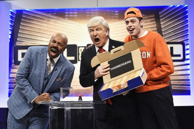 Left to Right Kenan Thompson as Steve Harvey, Alec Baldwin as President Donald Trump and Pete Davidson as a Clemson student during the Deal or No Deal Cold Open sketch on Saturday's edition of SNL. Photo by Will Heath/NBC