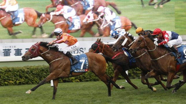 In another big event, Helene Paragon surges to victory in Monday's Group 1 Stewards Cup before a huge New Year's weekend crowd at Sha Tin. (HKJC photo)
