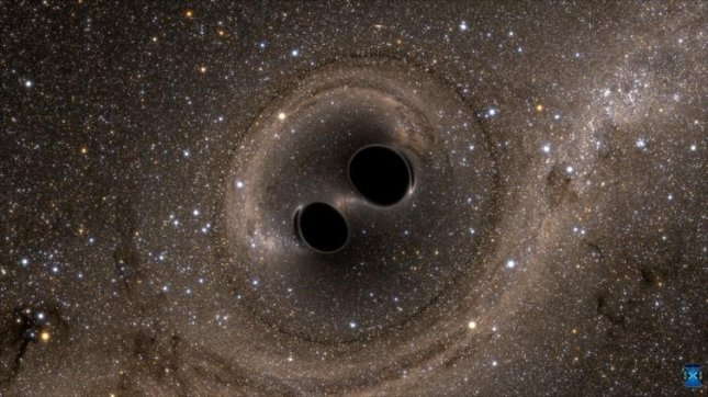 An illustration of the collision of two black holes, an event detected for the first time ever by the Laser Interferometer Gravitational-Wave Observatory. Image courtesy of the SXS (Simulating eXtreme Spacetimes) Project