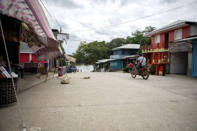 The main street in La Técnica, Guatemala, leads to a boat ramp on the Usumacinta River, which forms the international border with Mexico. Photo by Miguel Gutierrez Jr./The Texas Tribune